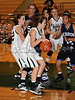Carroll freshman guard Caitlin Barrett dribbles into the lane in the game Friday night against Hebron.
