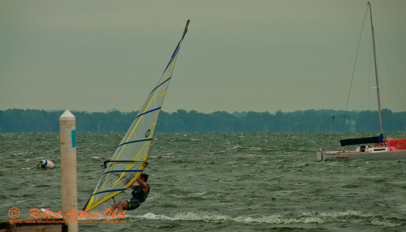 Gusty breezes drive fast and exciting wind surfing in front of the University of Wisconsin Madison's Memorial Union Terrace on Lake Mendota (USA WI Madison; Obst FAV Photos 2012 Nikon D300s Image 2790)