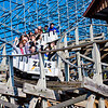 Zeus roller coaster riders enjoying a wild ride under blue skies on a gorgeous early spring day within Mt. Olympus Outdoor Theme Park (USA WI Wisconsin Dells; Obst FAV Photos 2013 Nikon D800 Sports Fun Extraordinaire Image 8524)