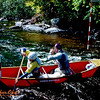 Bill Hoisington and Bob Obst racing their tandem whitewater open canoe at the University of Wisconsin Hoofers Outing Club sponsored Last Ditch whitewater slalom at Gilmores Mistake Rapids on the Wolf River during September 1989 (USA WI White Lake)