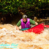 Whitewater solo canoeist Charles Frisk risk of capsize route through the upper reversal or souse hole of Tea Kettle or Upper Dalles Rapids at a river flow of 744 CFS on the wild Wolf River Section 4 within Menominee Indian Nation  (USA WI Keshena)