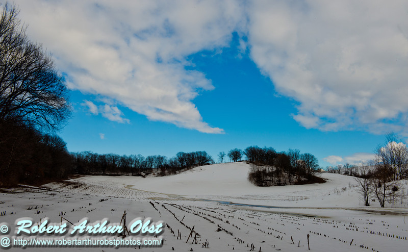 Cross country skier's view east of afternoon sun and blue skies over snowy farm fields during early spring near Indian Lake County Park (USA WI Cross Plains; Obst FAV 2013 Sports Fun Extraordinaire Action Outdoors Image 8382)