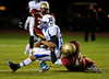 11/8/2013 Mike Orazzi | Staff New Britain's Josh Graves (43) brings down's Glastonbury's Romelle Jack (22) during Friday night's football game at Veteran's Stadium in New Britain.