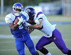 9/14/2013 Mike Orazzi | Staff<br /> CCSU's Rob Hollomon (22) and Holy Cross' Matt Bhaya (15) in New Britain on Saturday.