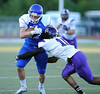 9/14/2013 Mike Orazzi | Staff CCSU's Matt Braddock (82) and Holy Cross' Parris Johnson (16) in New Britain on Saturday.