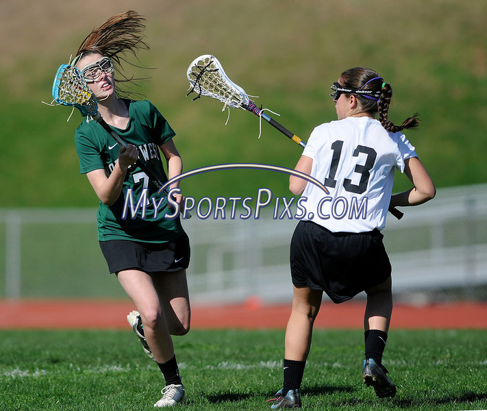 4/25/2013 Mike Orazzi | Staff Bristol girl's lacrosse's Leah Winarski (13) and Northwest Catholic's Molly Deneen  (7) at BEHS on Thursday afternoon.