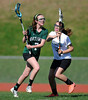 4/25/2013 Mike Orazzi | Staff Bristol girl's lacrosse's Kyla Nichols (12)  and Northwest Catholic's Molly Deneen  (7) at BEHS on Thursday afternoon.
