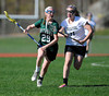 4/25/2013 Mike Orazzi | Staff Bristol girl's lacrosse's Shelby Folson (11) and Northwest Catholic's Grace Hayes (29) at BEHS on Thursday afternoon.