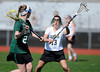 4/25/2013 Mike Orazzi | Staff Bristol girl's lacrosse's Leah Winarski (13) and Northwest Catholic's Grace Hayes (29) at BEHS on Thursday afternoon.