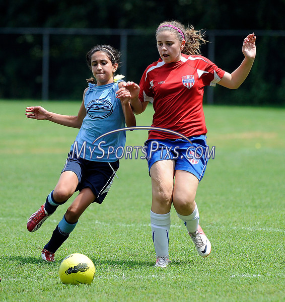 7/27/2013 Mike Orazzi | Staff Foundation SC's Lea Cabral (3) and Bristol U11's Amy Kucknel (21)during a gold medal game at Willowbrook Park in New Britain on Saturday afternoon.