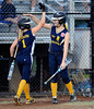 7/26/2013 Mike Orazzi | Staff New Jersey's McKenzie Medders (1) and Alexa Petito (13) celebrate a run during an 11-0 Jersey win over New York  in the 2013 Little League Softball Eastern Regional final at Breen Field on Friday night.