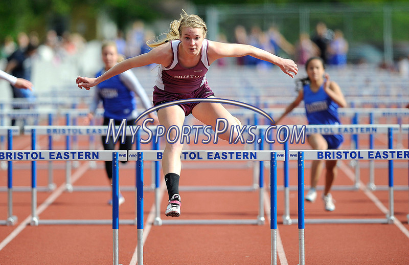 4/14/2013 Mike Orazzi | Staff Bristol Central's Lauren Bossi takes first place in the 100 hurdles against Bristol Eastern at Eastern on Tuesday.