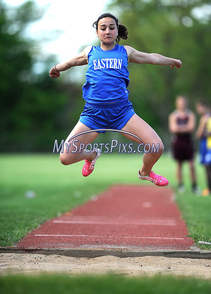 4/14/2013 Mike Orazzi | Staff Bristol Eastern's Meri Darragjati  in the long jump against Bristol Central at Eastern on Tuesday.
