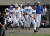 6/10/2014 Mike Orazzi | Staff<br /> Southington High School baseball players celebrate a win over Fairfield Warde in the Class LL Semifinal at Muzzy Field in Bristol Tuesday evening.