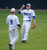 6/10/2014 Mike Orazzi | Staff<br /> Southington's Joseph Daigle (9) and Brett Shaw (4) during a win over the Class LL Semifinal at Muzzy Field in Bristol Tuesday evening.