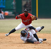 4/4/2014 Mike Orazzi | Staff<br /> Rock Cat's Corey Wimberly (1) forces out Richmond Flying Squirrels' Ricky Oropesa (33) at second in New Britain Friday.