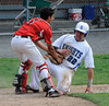 6/10/2014 Mike Orazzi | Staff<br /> Southington's Liam Scafariello (22) tagged out by Fairfield Warde's Anthony Miller (4) during a win over the Class LL Semifinal at Muzzy Field in Bristol Tuesday evening.