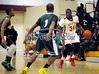 3/1/2014 Mike Orazzi   Staff<br /> New Britain's Annuel Saint Juste (34) and Weaver's Jaecee Martin(1) during the CCC Boys Basketball Tournament at Bulkeley High School Saturday night in Hartford.