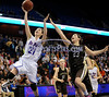 3/22/2014 Mike Orazzi | Staff<br /> Thomaston High School's Sarah Guay (23) and St. Paul Catholic's Elisabeth Cretella (21) during the CIAC 2014 State Girls Basketball Tournament Class S Final at Mohegan Sun Arena Saturday. Thomaston won 61-57 in double over-time.