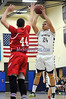 2/19/2014 Mike Orazzi | Staff Newington's Marcus Guadarrama  (24) and Conard's Caleb LaRosa  (44) at NHS on Wednesday night.
