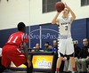 2/19/2014 Mike Orazzi | Staff Newington's Jared Simmons (3) and Conard's Karon Golding (11) at NHS on Wednesday night.