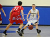 2/19/2014 Mike Orazzi | Staff Newington's Zachary Tinkham (4) and Conard's Travis Sinatro (21) at NHS on Wednesday night.