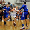 2/27/2014 Mike Orazzi | Staff Bristol Central's Joey DeFillippi (5) and Glastonbury's Christian Porydzy (25) and John Russell (23) during the CCC Tournament at BC Thursday night.