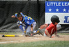 8/7/2014 Mike Orazzi | Staff<br /> Rhode Island's Christopher Davock (5) scores as Maine's Francis Kiely (99) applies the tag at home during the Eastern Regional Little League Tournament at Breen Field in Bristol on Thursday.