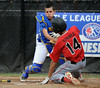 8/7/2014 Mike Orazzi | Staff<br /> Falmouth Maine's Francis Kiely (99) tags out Rhode Island's Jayden Struble (14) during the Eastern Regional Little League Tournament at Breen Field in Bristol on Thursday.