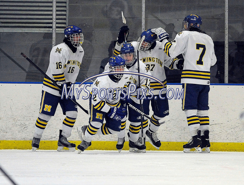3/6/2014 Mike Orazzi | Staff Newington-Berlin-Manchester players celebrate a goal during the 2014 CCC Ice Hockey Tournament at  the Newington Ice Arena Thursday afternoon.