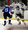 3/6/2014 Mike Orazzi | Staff Newington-Berlin-Manchester's Christopher Salvio (18) and Hall-Southington's Cody Backus (27) during the 2014 CCC Ice Hockey Tournament at  the Newington Ice Arena Thursday afternoon.