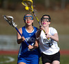 4/9/2014 Mike Orazzi   Staff<br /> Bristol Eastern's Steph Sacharko (21) and Newington's Hannah Martin (16) during Wednesday's match with Newington at Eastern.