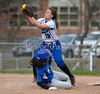 4/18/2014 Mike Orazzi | Staff Southington High School's Sydney Ferrante (13) steals second as Bristol Eastern's Charline Plasczynski (13) takes the throw Friday.
