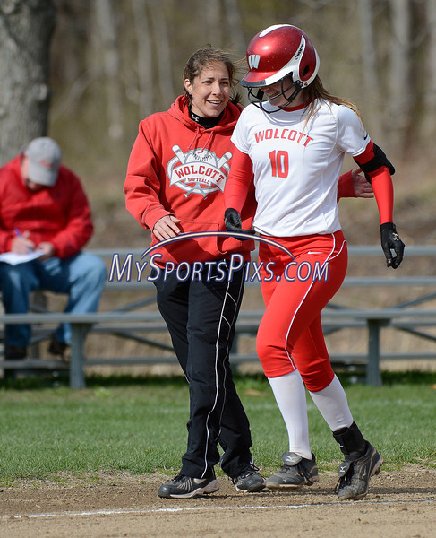 4/23/2014 Mike Orazzi | Staff Wolcott High School's Kayla DePara (10) hits a two run home run during Wednesday's softball game with St. Paul in Bristol.