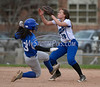 4/18/2014 Mike Orazzi | Staff Southington High School's Sydney Ferrante (13) steals second as Bristol Eastern's Charline Plasczynski takes the throw Friday.