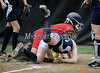 7/19/2014 Mike Orazzi | Staff<br /> Maine's Madison Blanche (9) scores as Vermont's Rachel Yandow runs her down during the Little League Softball Eastern Regional Tournament at Leon Breen Memorial Field in Bristol on Saturday.
