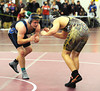 2/22/2014 Mike Orazzi | Staff Bristol Eastern's Tyler Dionne and Farmington's Jeffrey Fuller in a 195 match at Bristol Central on Saturday.
