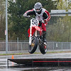 At the Season Opener for BC Supermoto, Rider # 58, Zoltan Gyulasi gives me a wheel wave as he clears the small jump just after turn # 1. As you can see it was a very wet rainy day, but hey riding is riding.