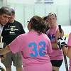 The Lady Sparks (white, a development team for Team USA in the World ball Hockey Championships) play the Lady Whalers (pink), who are from central and western Mass. and mostly play in Leominster. Lady Whalers coach Jim Billingham talks to players during a break. (SUN/Julia Malakie)
