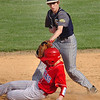 #9 for Rye Cove puts the tag on Twin Springs' #11 as he slides past. Photo by Ned Jilton II