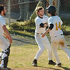Teammates rush out to greet #14 of Sullivan North after he crossed the plate for the winning run. Photo by Ned Jilton II
