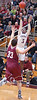 Dobyns-Bennett's #3, Makale Foreman, launches a three over Oak Ridge's #33, Isaac Merian. Photo by Ned Jilton II