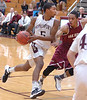 Dobyns-Bennett's #5, Tyleke Love, drives aginst Oak Ridge's #3, Kevin Steen. Photo by Ned Jilton II
