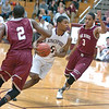Dobyns-Bennett's #5, Tyleke Love, drives between Oak Ridge's #2, Jaylin Henderson, and #3, Kevin Steen. Photo by Ned Jilton II