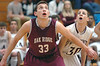 Oak Ridge's #33, Isaac Merian, blocks out Dobyns Bennett's #30, Cason Byrd. Photo by Ned Jilton II