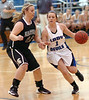 #1 for Castlewood, Haley Crabtree,brings ball upcourt against #11 for Eastside, Lindsay Dean. Photo by Ned Jilton II