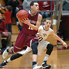 Oak Ridge's #12, Geevantay Gee, drives past Dobyns Bennett's #30, Cason Byrd. Photo by Ned Jilton II