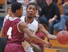 Dobyns-Bennett's #5, Tyleke Love, passes around Oak Ridge's #4, Ted Mitchell. Photo by Ned Jilton II