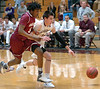 Dobyns-Bennett's #20, John Fulkerson, and Oak Ridge's #5, Seth Davis, scramble after loose ball. Photo by Ned Jilton II
