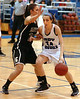 #34, McKinley Isaaces, for Castlewood drives against #20, Erin Stanley, of Eastside. Photo by Ned Jilton II